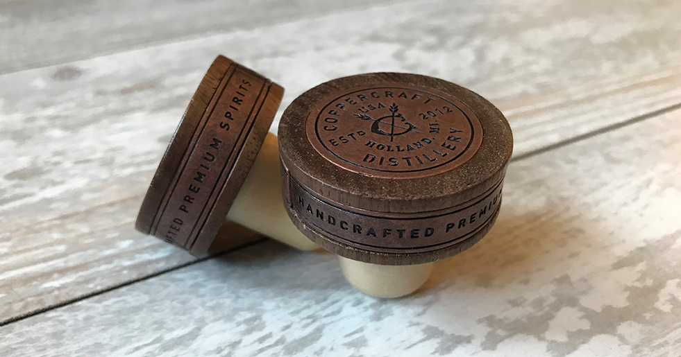 Custom Wood Stopper with Metal Decoration on the sides and medallion by Big Sky Packaging for Coppercraft Distillery