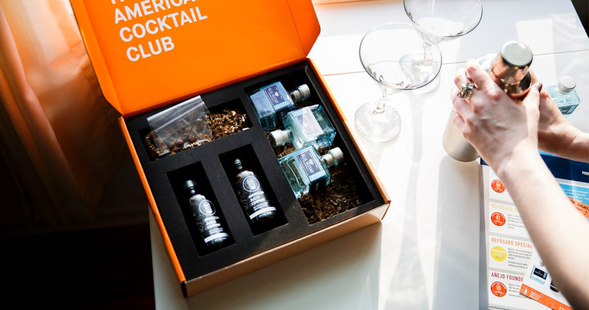 Custom ecommerce cocktail subscription box with a laser cut insert used in the spirits industry.